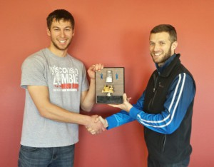 Adam Susa (left) accepts the Mover and Shaker Award from Wisconsin Hybrid Team Leader Weston Hartman (left).