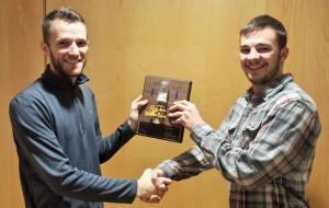 Nathan Karabon (right) accepts the Mover and Shaker Award from Wisconsin Hybrid team leader Weston Hartman (left).