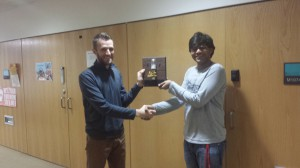 Roumen Guha (right) accepts the Mover n Shaker Award from Weston Hartman (left) the Wisconsin Hybrid team leader.