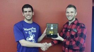 Matt Culcyk (left) accepts the Mover and Shaker Award from Wisconsin Hybrid Team Leader Weston Hartman (right).