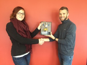 Sarah Murphy (right) accepts the Mover and Shaker Award from Wisconsin Hybrid Team Leader Weston Hartman (left).